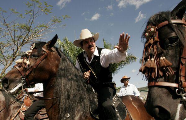 Il presidente honduregno Manuel Zelaya durante una tradizionale sfilata equestre a Palmares, a nord-ovest della capitale di San Jose, Costa Rica - Sputnik Italia