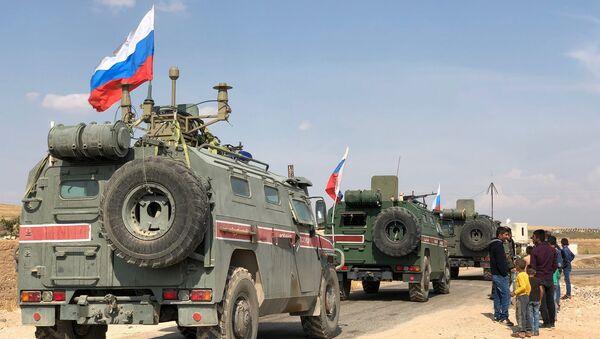 Il pattugliamento russo del confine siro-turco vicino la città di Kobani - Sputnik Italia