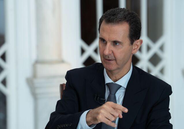 Assad durante un'intervista