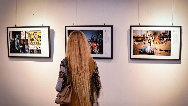 L'inaugurazione della mostra dedicata alle fotografie vincitrici del Concorso Stenin a Cascina Roma, San Donato Milanese - Sputnik Italia