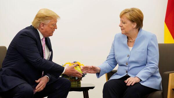 Donald Trump e Angela Merkel - Sputnik Italia