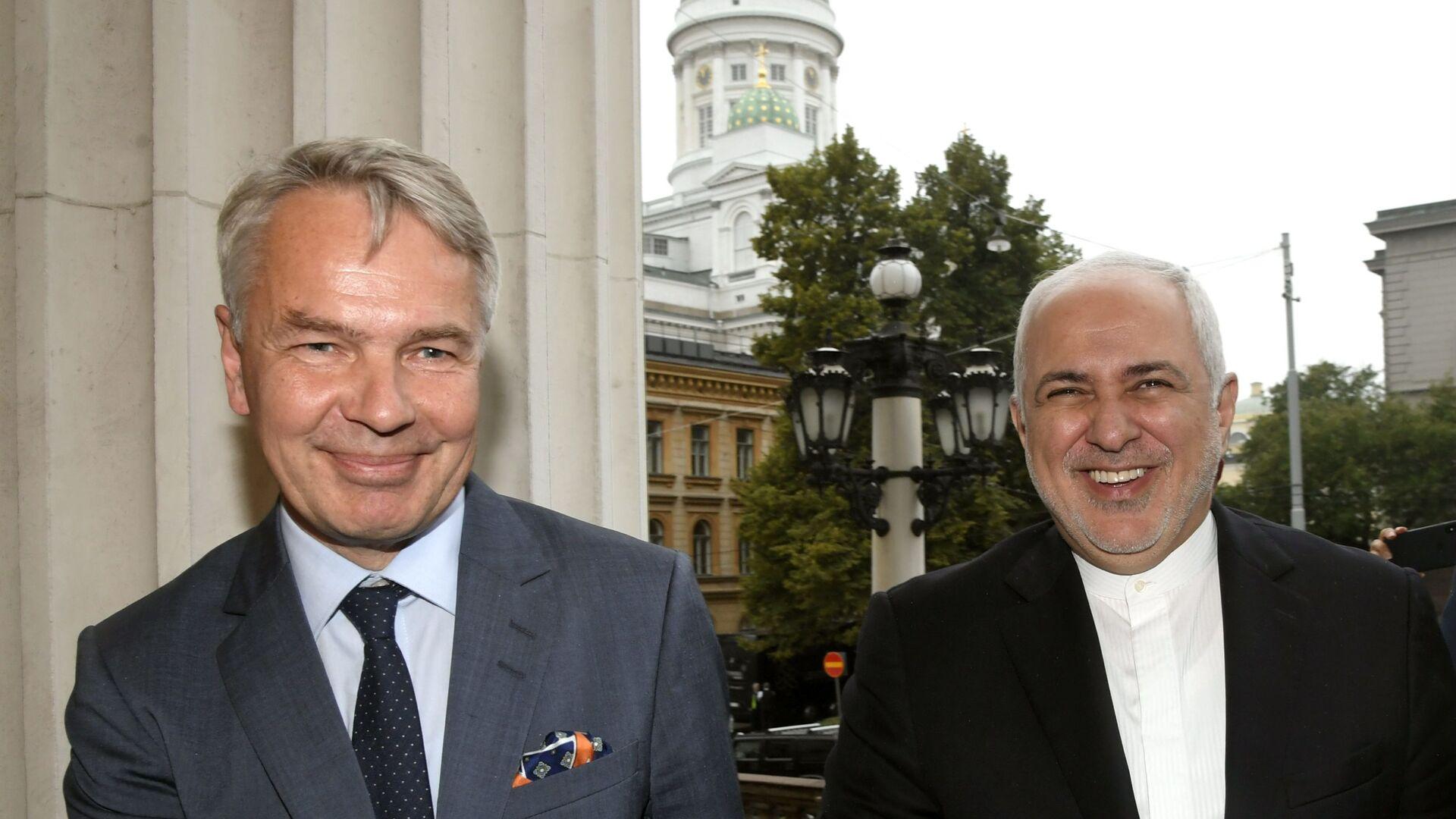 Il primo ministro della Finlandia Pekka Haavisto (L) ed il ministro degli Esteri dell'Iran Mohammed Javad Zarif a Helsinki - Sputnik Italia, 1920, 08.07.2021