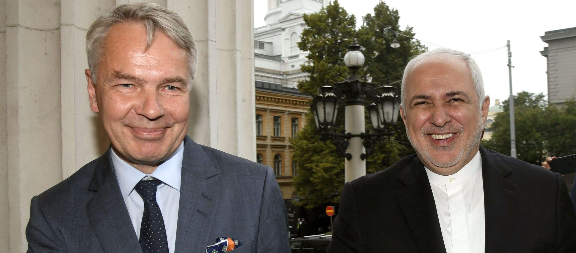 Il primo ministro della Finlandia Pekka Haavisto (L) ed il ministro degli Esteri dell'Iran Mohammed Javad Zarif a Helsinki - Sputnik Italia, 1920, 29.11.2019