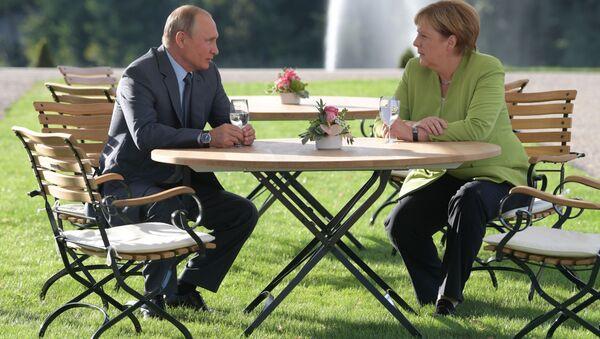 Putin e Merkel - Sputnik Italia