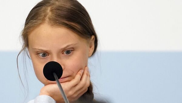 Climate change activist Greta Thunberg reacts during a news conference during COP25 climate summit in Madrid, Spain, December 9, 2019 - Sputnik Italia