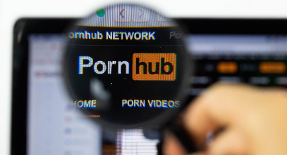 Pornhub logo on a computer screen with a magnifying glass