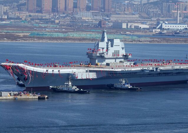 Type 001A, China's second aircraft carrier, is transferred from the dry dock into the water during a launch ceremony at Dalian shipyard in Dalian, northeast China's Liaoning Province, April 26, 2017