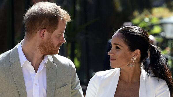 Il principe Harry e la moglie Meghan, Duca e Duchessa del Sussex. - Sputnik Italia
