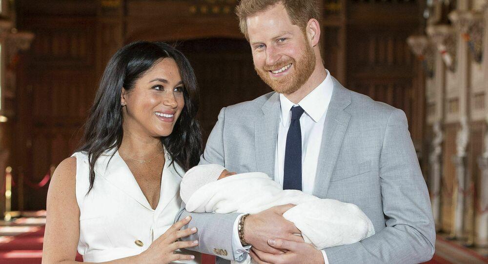 Harry e Meghan con Archie