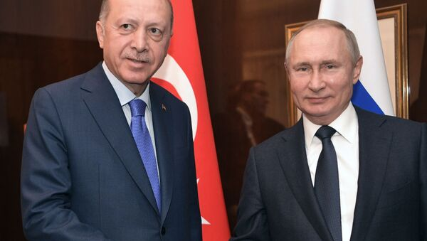Il presidente russo Vladimir Putin durante un incontro con il presidente turco Recep Tayyip Erdogan alla Conferenza internazionale sulla Libia a Berlino - Sputnik Italia