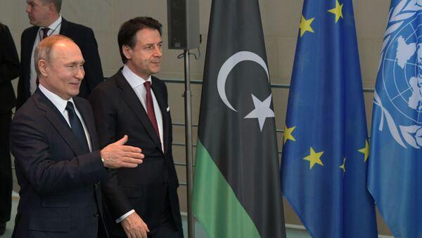 Il presidente russo Vladimir Putin e Il Primo ministro italiano Giuseppe Conte alla Conferenza internazionale sulla Libia a Berlino - Sputnik Italia