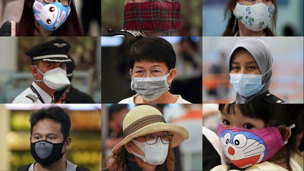 La gente indossa mascherine svariate all'ufficio immigrazioni all'aeroporto della città di Sepang, Malaysia - Sputnik Italia