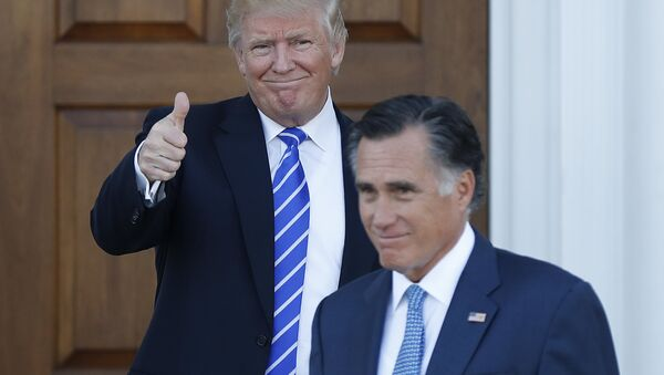 In this Nov. 19, 2016, file photo, shows President-elect Donald Trump giving the thumbs-up as Mitt Romney leaves Trump National Golf Club Bedminster in Bedminster, N.J. - Sputnik Italia