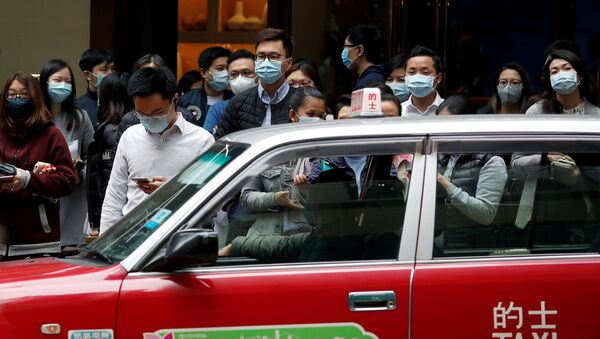 La gente nelle maschere a Hong Kong - Sputnik Italia