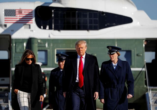 U.S. President Donald Trump and first lady Melania Trump walk from Marine One to board Air Force One to depart Washington for travel to India