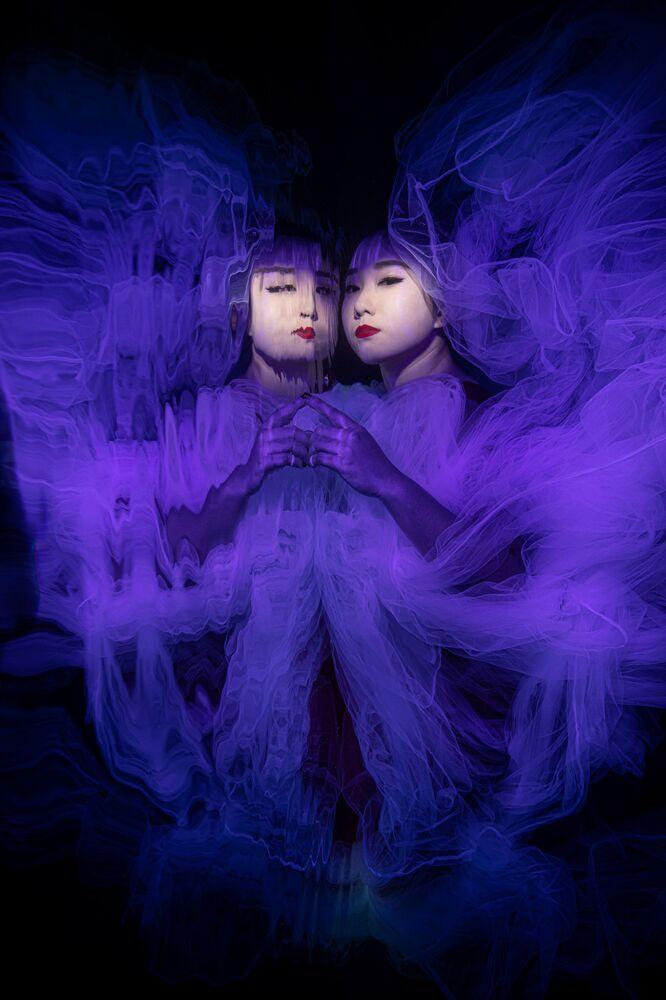 Butterfly Effect (Effetto farfalla) è la foto del fotografo singaporiano Lilian Koh.