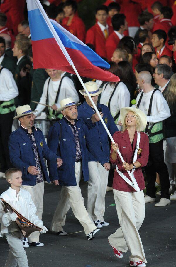 La portabandiera della nazionale russa, la tennista Maria Sharapova, alla cerimonia dell'apertura delle Olimpiadi a Londra. - Sputnik Italia