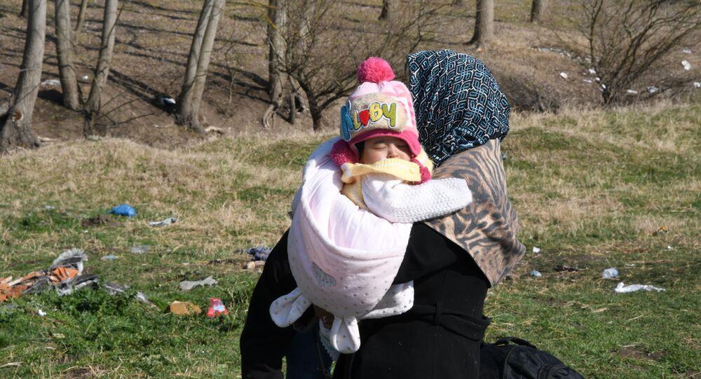 Rifugiati alla frontiera tra Turchia e Grecia