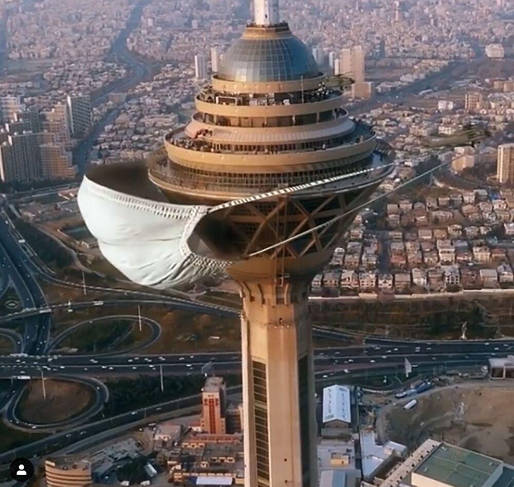 L'artista iraniano Hamid Ebrahimnia ha messo alla torre Milad di Teheran, la più alta in Iran, una mascherina gigantesca.