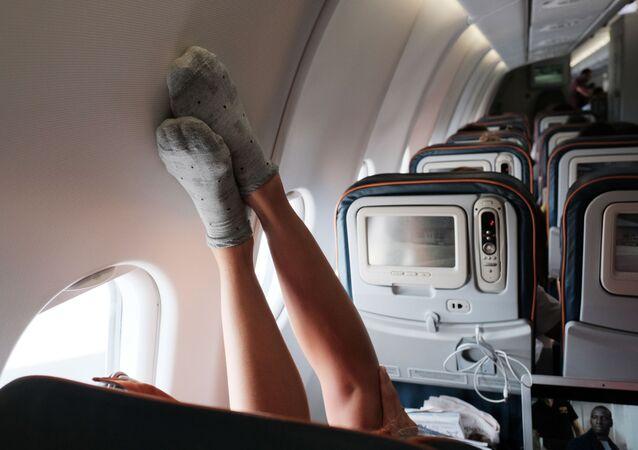 Passeggere in un aereo