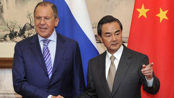 Sergey Lavrov e Wang Yi - Sputnik Italia