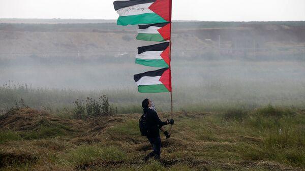 Le proteste dei palestinesi nella Striscia di Gaza al confine con l'Israele - Sputnik Italia