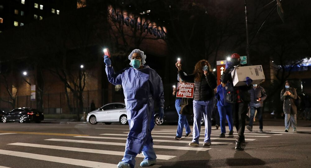 Nurses gather for a candlelight vigil to honor healthcare workers, during the outbreak of the coronavirus disease (COVID-19) at Lincoln Hospital in the Bronx borough of New York City, U.S., April 14, 2020