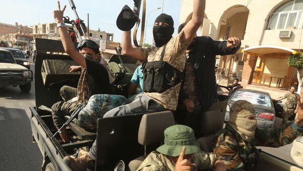 Uomini leali al Governo di Accordo Nazionale (GNA) commemorano la conquista della città di Sabratha, Libia 13 aprile 2020 - Sputnik Italia