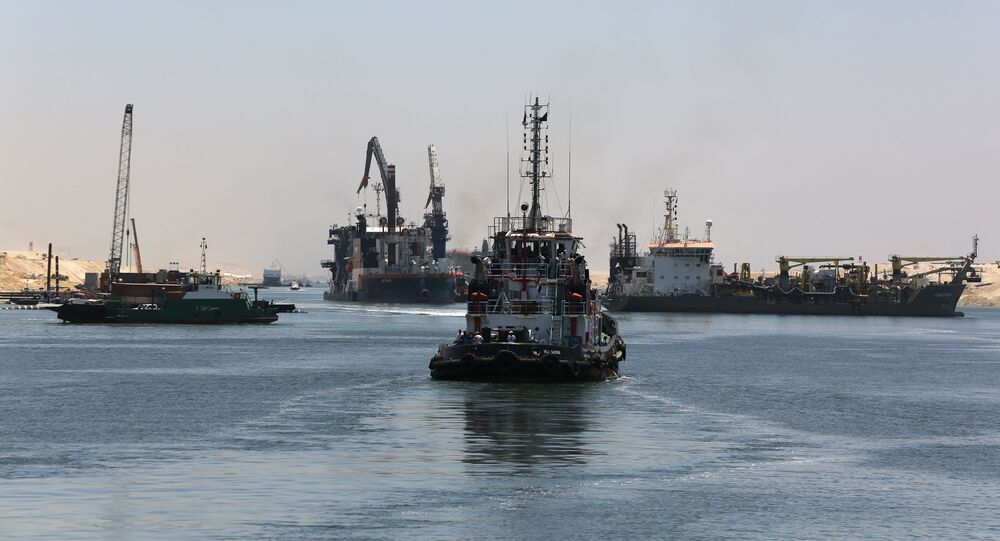 Ships are seen crossing through the New Suez Canal, Ismailia, Egypt, July 29, 2015