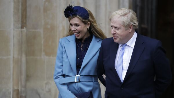 """In this Monday, March 9, 2020 file photo Britain's Prime Minister Boris Johnson and his partner Carrie Symonds arrive to attend the annual Commonwealth Day service at Westminster Abbey in London.  Boris Johnson and his partner Carrie Symonds have announced she gave birth to a healthy baby boy at a London hospital earlier this morning"""" Wednesday April 29, 2020, and that both mother and baby are doing well - Sputnik Italia"""