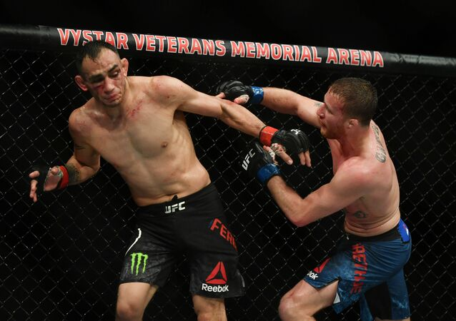 Tony Ferguson (red gloves) fights Justin Gaethje (blue gloves) during UFC 249 at VyStar Veterans Memorial Arena in Jacksonville, Florida