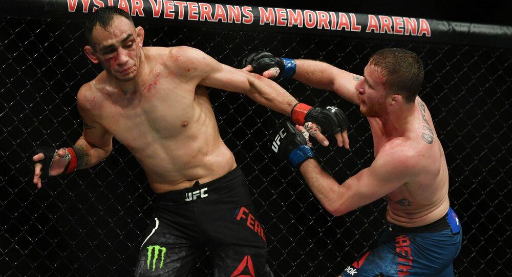 Tony Ferguson (red gloves) fights Justin Gaethje (blue gloves) during UFC 249 at VyStar Veterans Memorial Arena in Jacksonville, Florida
