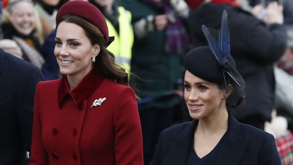 FILE - In this Tuesday, Dec. 25, 2018 file photo, Britain's Kate, Duchess of Cambridge, left, and Meghan, Duchess of Sussex arrive to attend the Christmas day service at St Mary Magdalene Church in Sandringham in Norfolk, England - Sputnik Italia