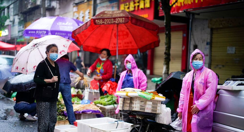 People wearing protective face masks are seen at a street market in Wuhan, the Chinese city hit the hardest by the coronavirus disease (COVID-19) outbreak, in the Hubei province, China, May 14, 2020.