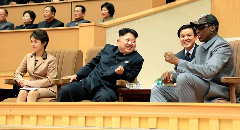 North Korean leader Kim Jong Un watches a basketball game with Dennis Rodman