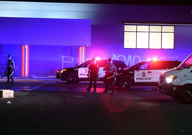 Police arrive along with firefighters to the looted Cub supermarket near the Minneapolis Police third precinct after a white police officer was caught on a bystander's video pressing his knee into the neck of African-American man George Floyd, who later died at a hospital, in Minneapolis, Minnesota, U.S. May 28, 2020.