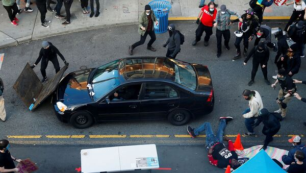 A man falls after being shot by a driver who tried to drive through a protest against racial inequality in the aftermath of the death in Minneapolis police custody of George Floyd, in Seattle, Washington, U.S. June 7, 2020 - Sputnik Italia