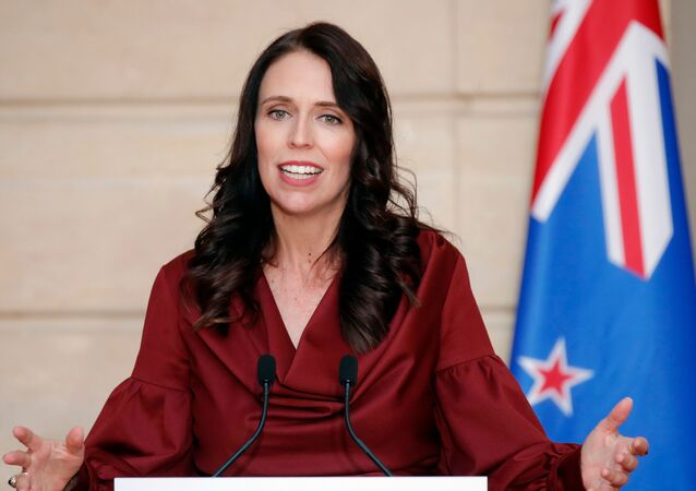 New Zealand Prime Minister Jacinda Ardern gestures as she speaks during a media conference with French President Emmanuel Macron, at the at the Elysee Palace in Paris, Monday, April 16, 2018