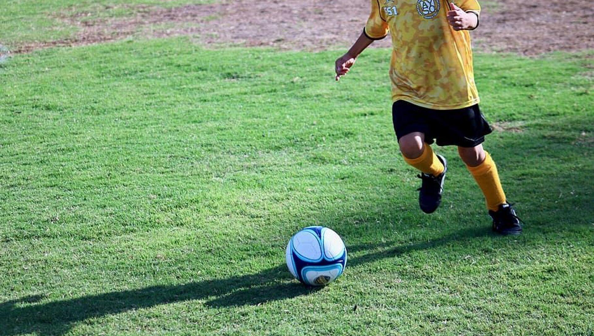 Bambino che gioca a calcio - Sputnik Italia, 1920, 21.04.2021