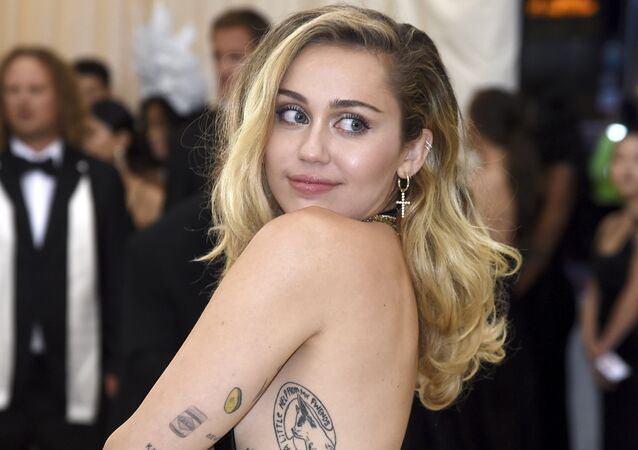 Miley Cyrus attends The Metropolitan Museum of Art's Costume Institute benefit gala celebrating the opening of the Heavenly Bodies: Fashion and the Catholic Imagination exhibition on Monday, May 7, 2018, in New York