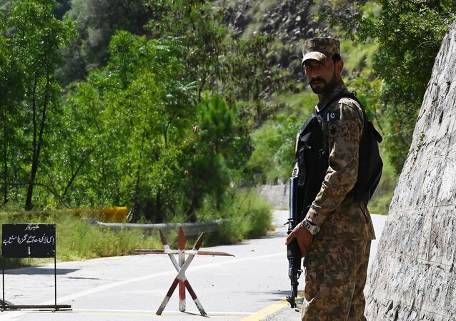 A Pakistani troop patrols near the Line of Control (LoC) --- the de facto border between Pakistan and India -- in Chakothi sector, in Pakistan-administered Kashmir on August 29, 2019.