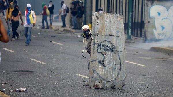 Opposizitori di Maduro protestano a Caracas,  Venezuela 10 aprile 2017 - Sputnik Italia
