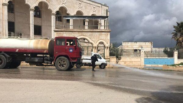 Sanificazione delle strade in Latakia, Siria - Sputnik Italia