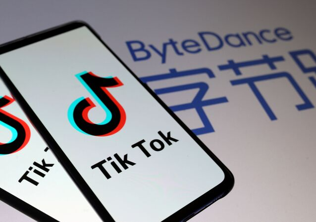 Tik Tok logos are seen on smartphones in front of a displayed ByteDance logo in this illustration taken November 27, 2019