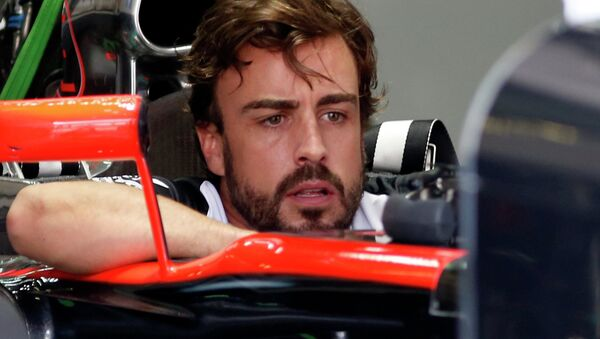 Formula One - F1 - Malaysian Grand Prix 2015 - Sepang International Circuit, Kuala Lumpur, Malaysia - 26/3/15 McLaren's Fernando Alonso sits in his car in the team garage - Sputnik Italia