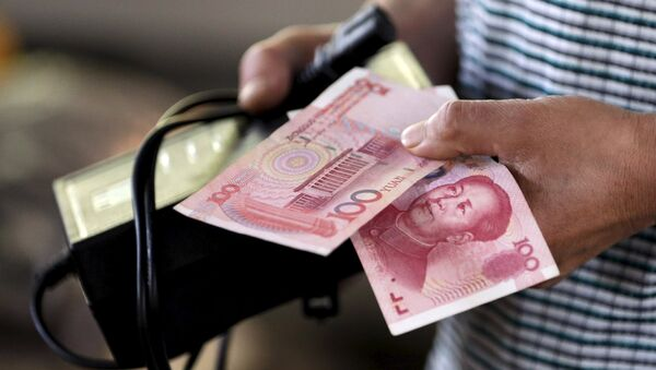 Banconote dello yuan - Sputnik Italia